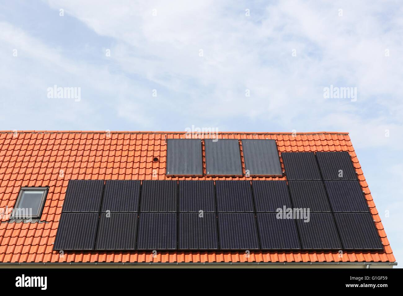House with solar panels on the roof - Stock Image