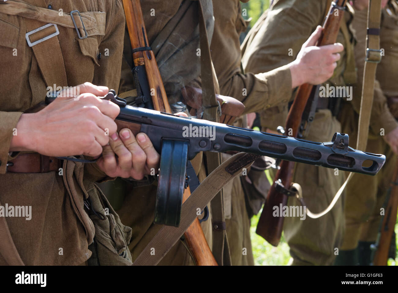 Russian machine gun in the hands of a soldier - Stock Image