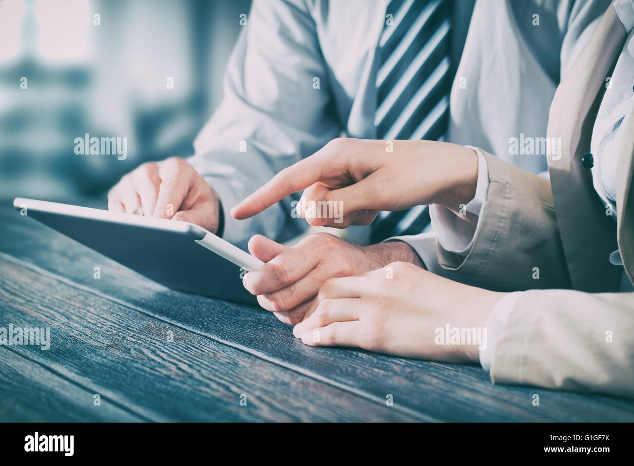 business meeting executive consulting review career report tablet - stock image - Stock Image