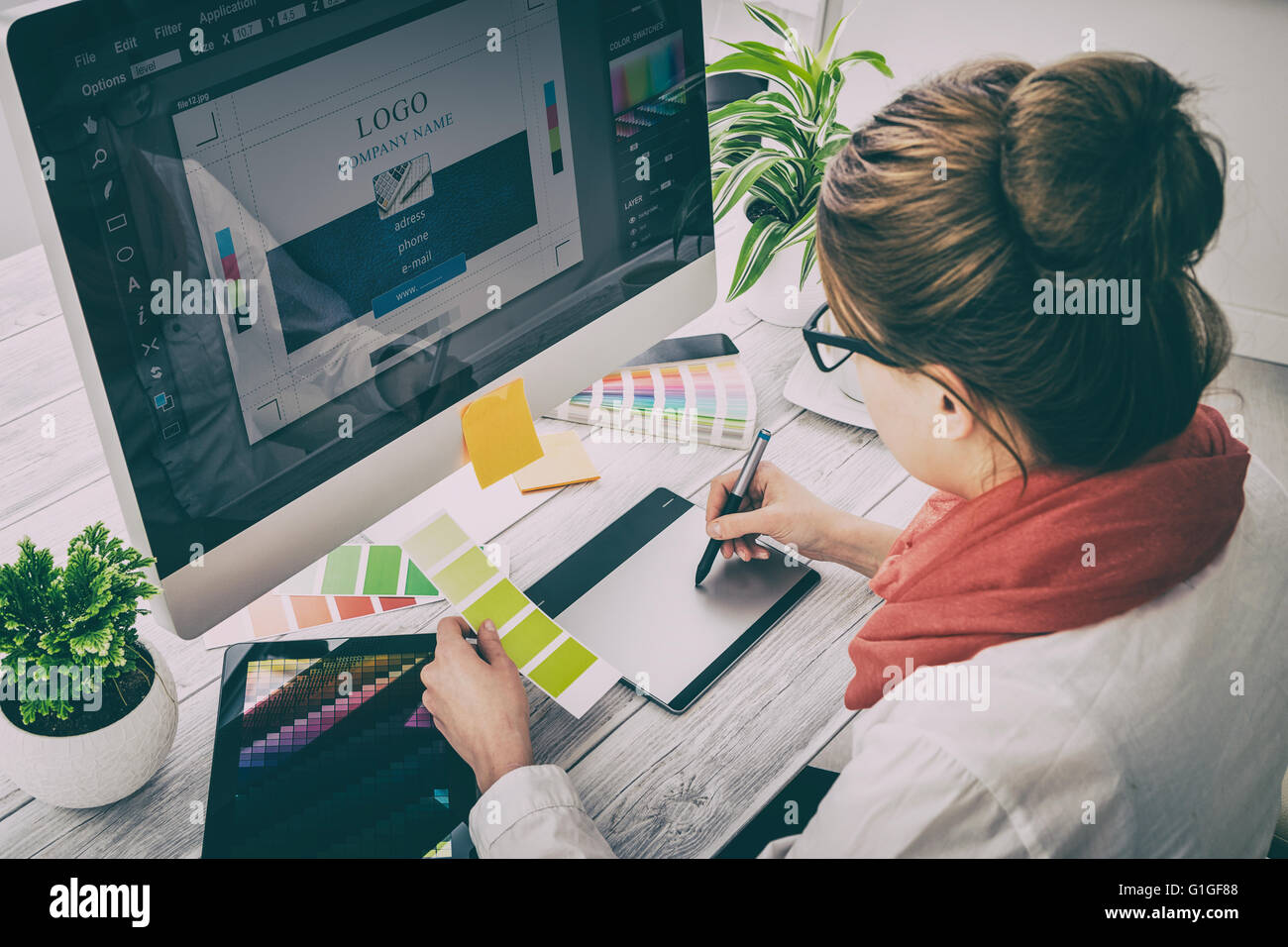 Graphic designer at work. Color swatch samples. - Stock Image
