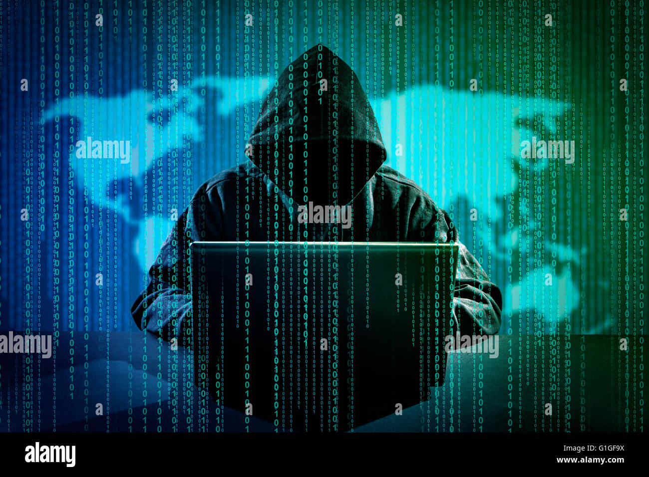 Hacker using laptop. Hacking the Internet. - Stock Image