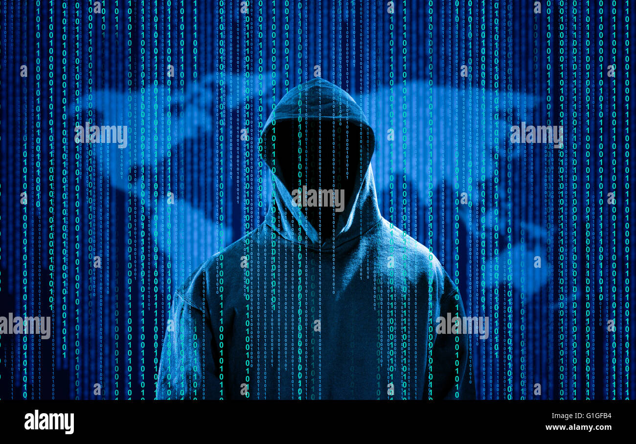 Hacker with a hood and binary code. Hacking the Internet. - Stock Image