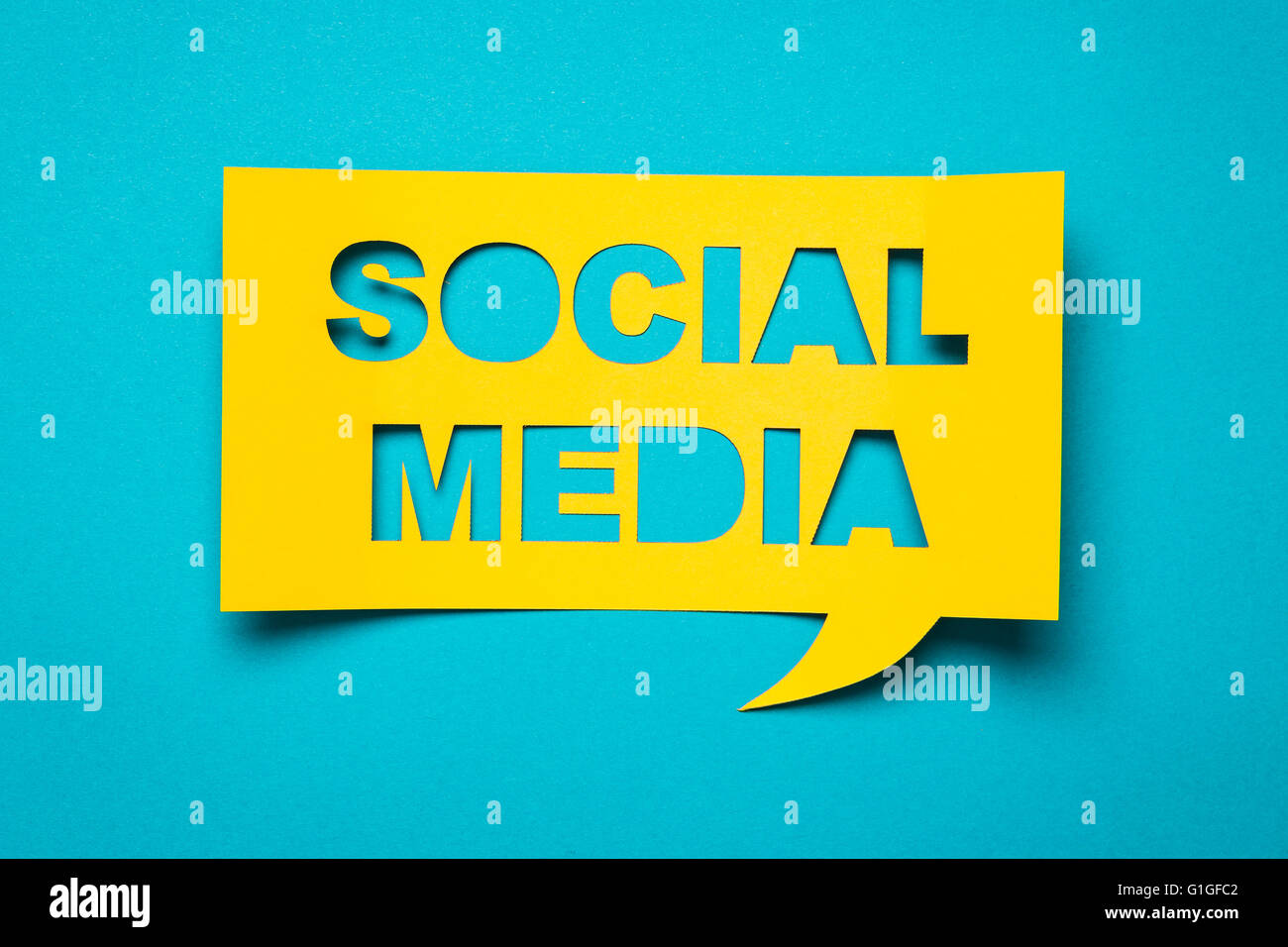 Bubble speech with cut out phrase 'social media' in the paper. - Stock Image