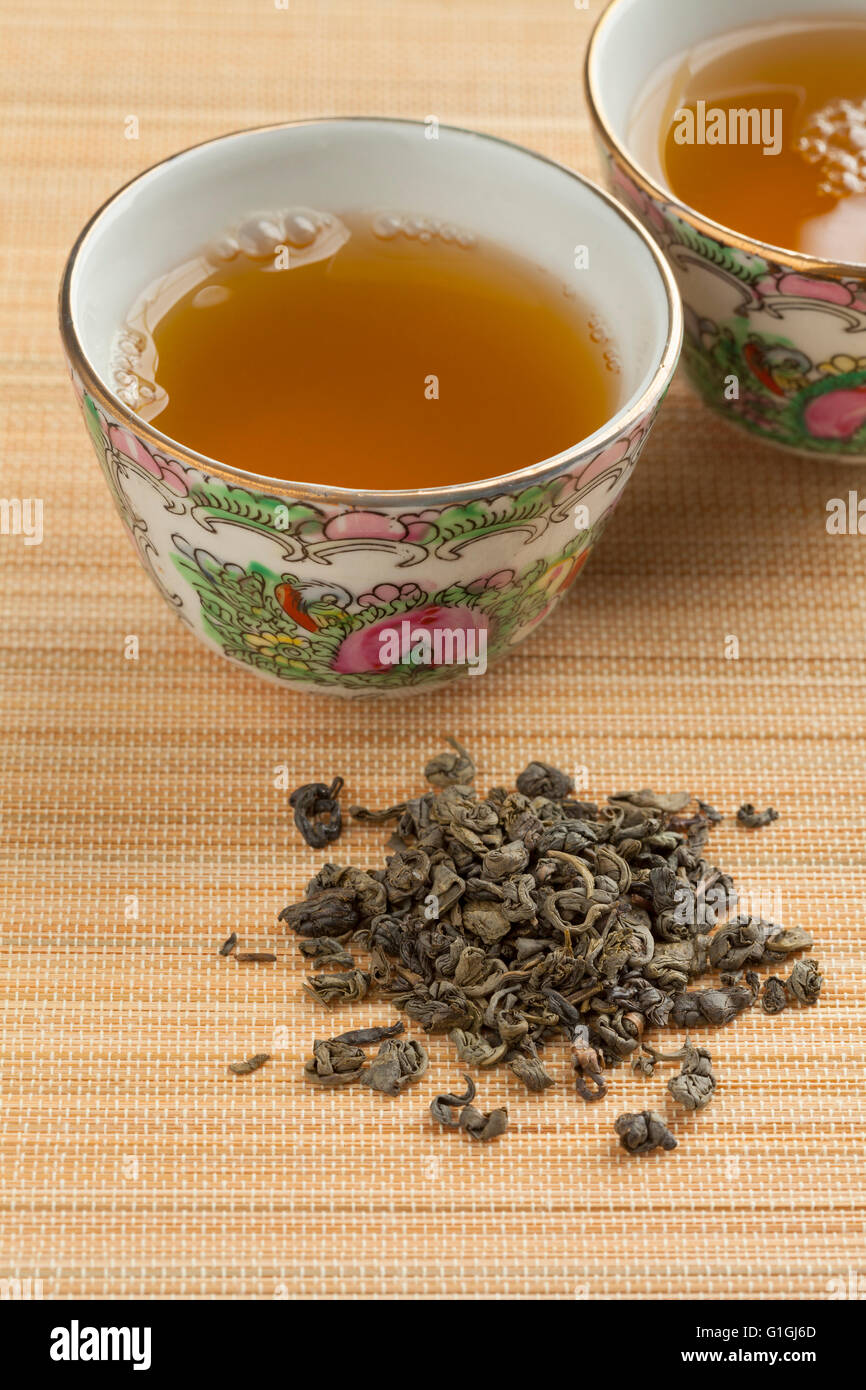 Two cups with green gunpowder tea - Stock Image