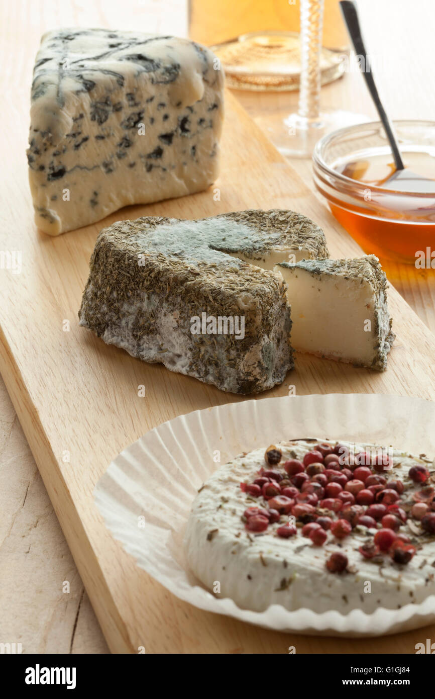 Traditional French cheese tray with a variety of cheese - Stock Image