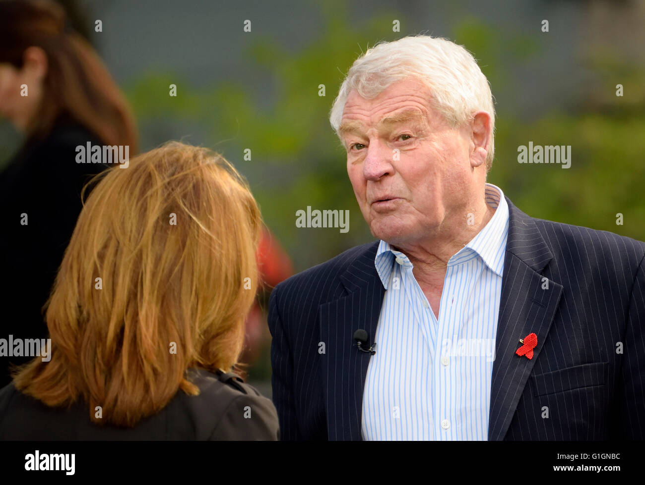 Paddy Ashdown, former leader Liberal Democratic Party, being interviewed for TV on College Green, Westminster..... Stock Photo
