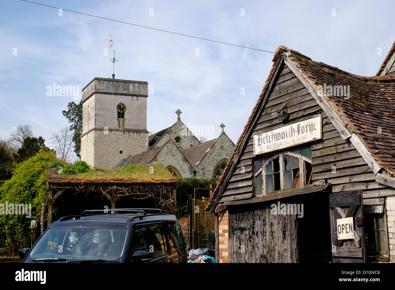 The village church and forge in Betchworth, just outside Dorking, Surrey - Stock Image