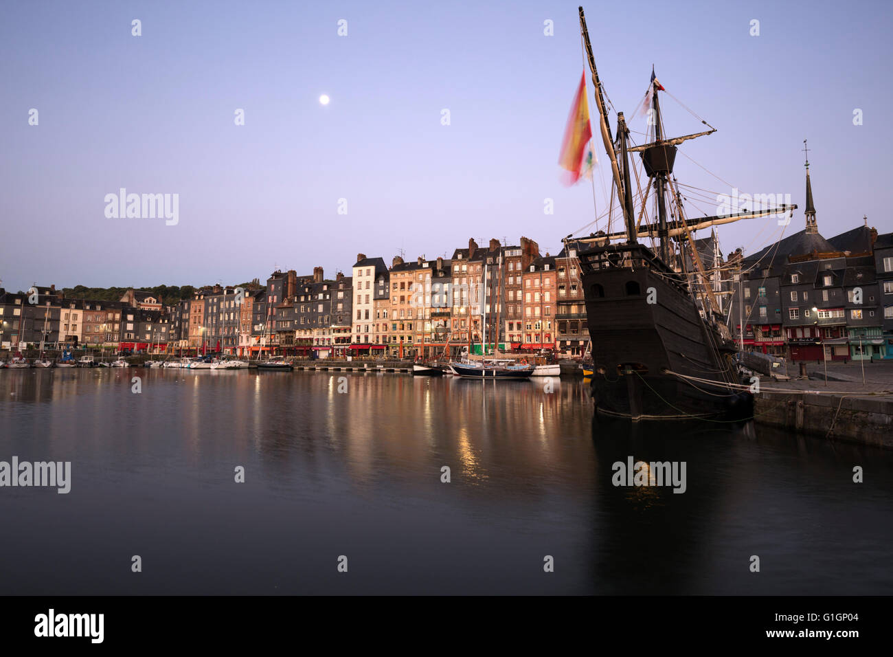 Vieux Bassin looking to Saint Catherine Quay with replica galleon at dawn, Honfleur, Normandy, France, Europe - Stock Image