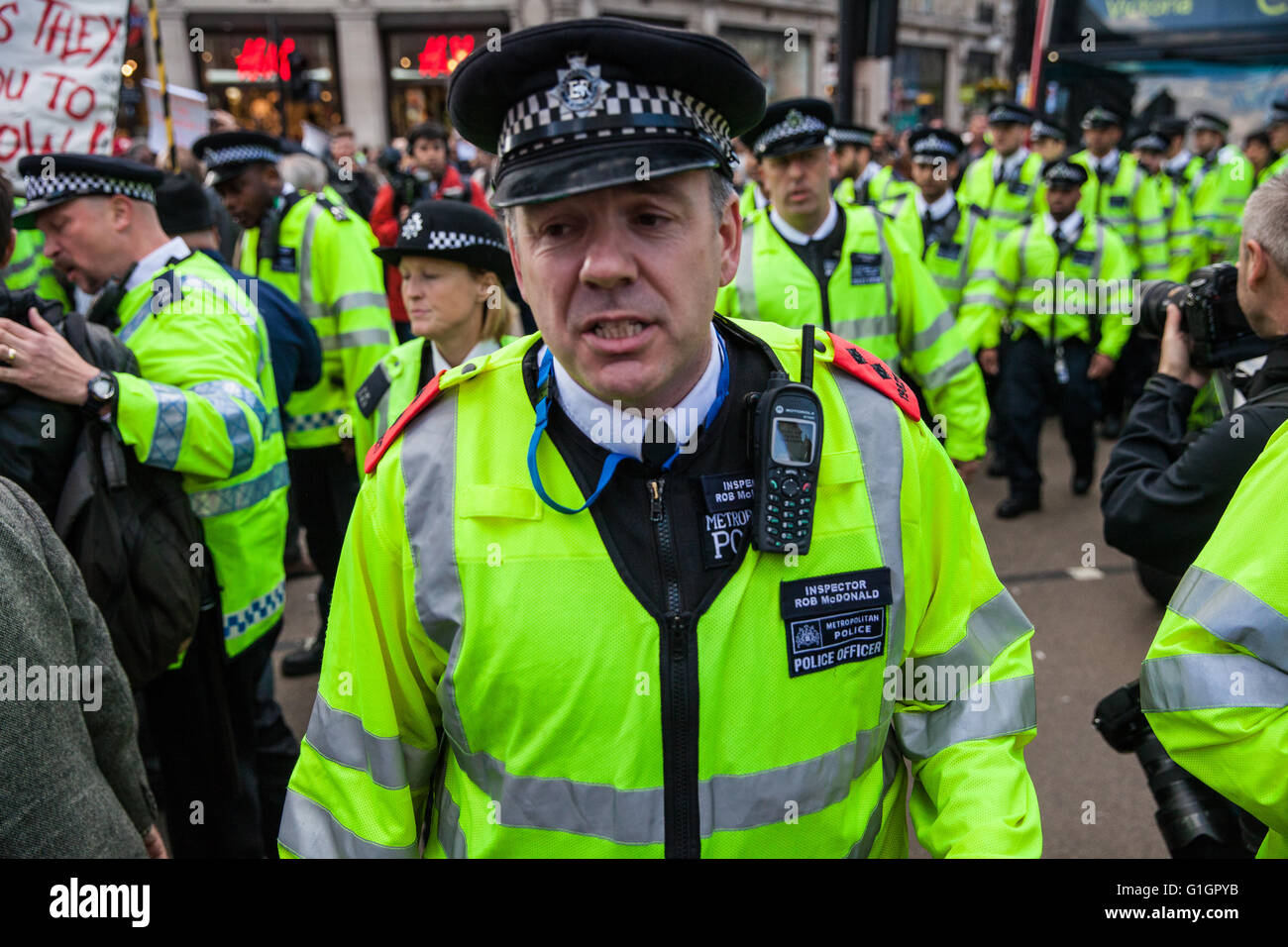 London, UK. 14th May, 2016. Police officers order protesters for a living wage and trade union rights to vacate - Stock Image