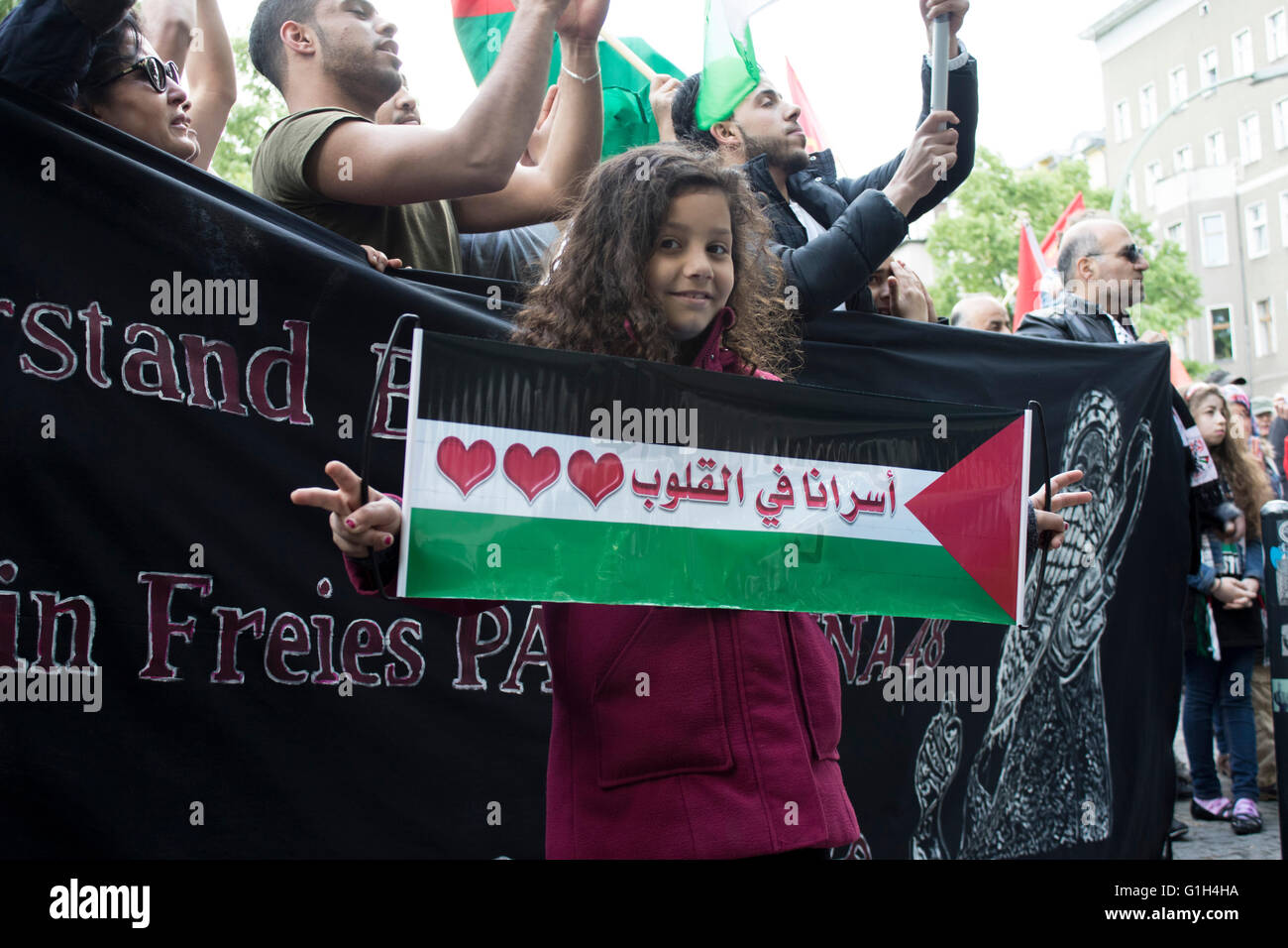 A young girl holds a banner calling for freedom for Palestine on Nakba Day (Day of the Catastrophe) in Berlin. Nakba - Stock Image