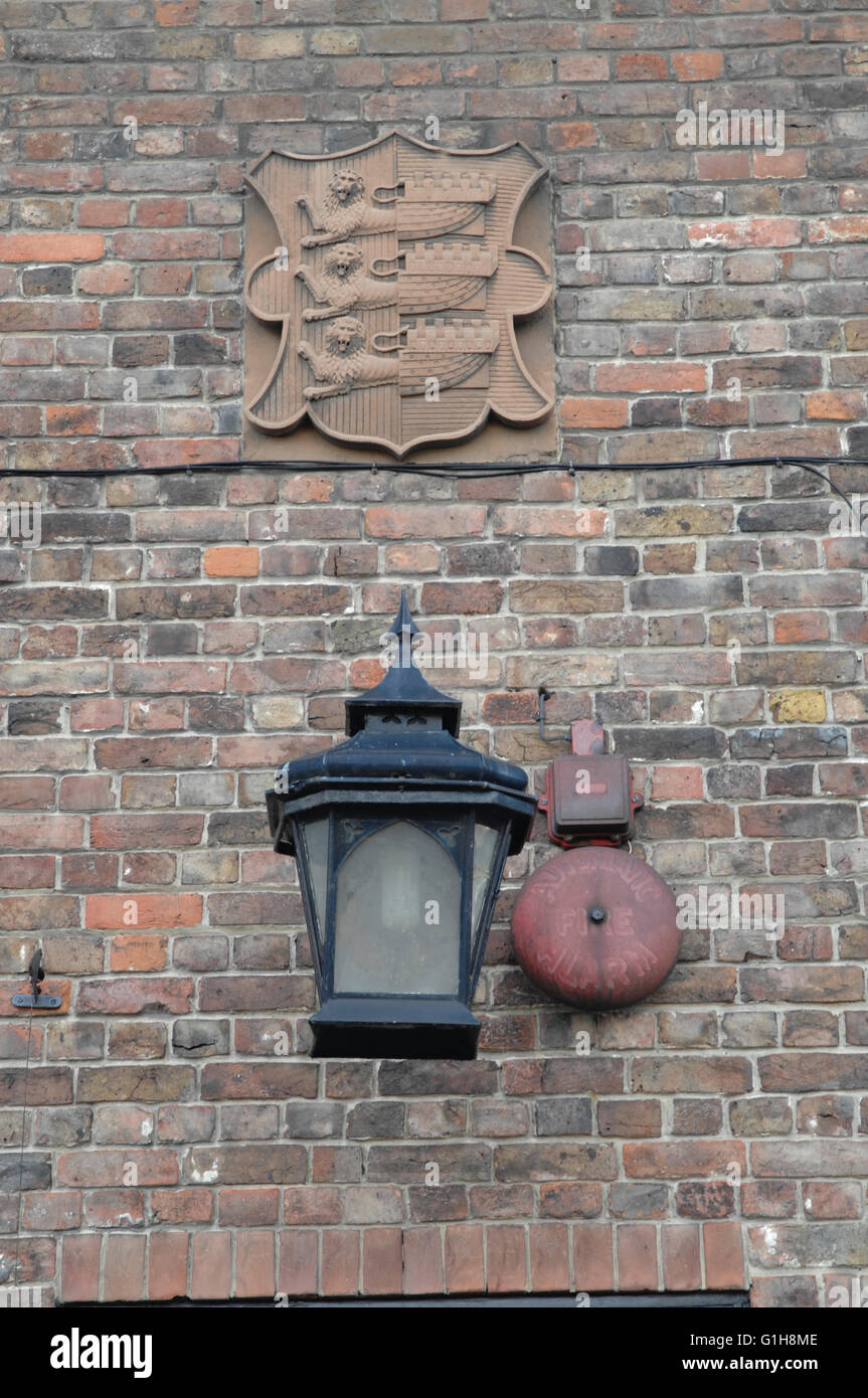 Old Street Lamp and Alarm Bell on building in the village of Sandwich Kent UK - Stock Image