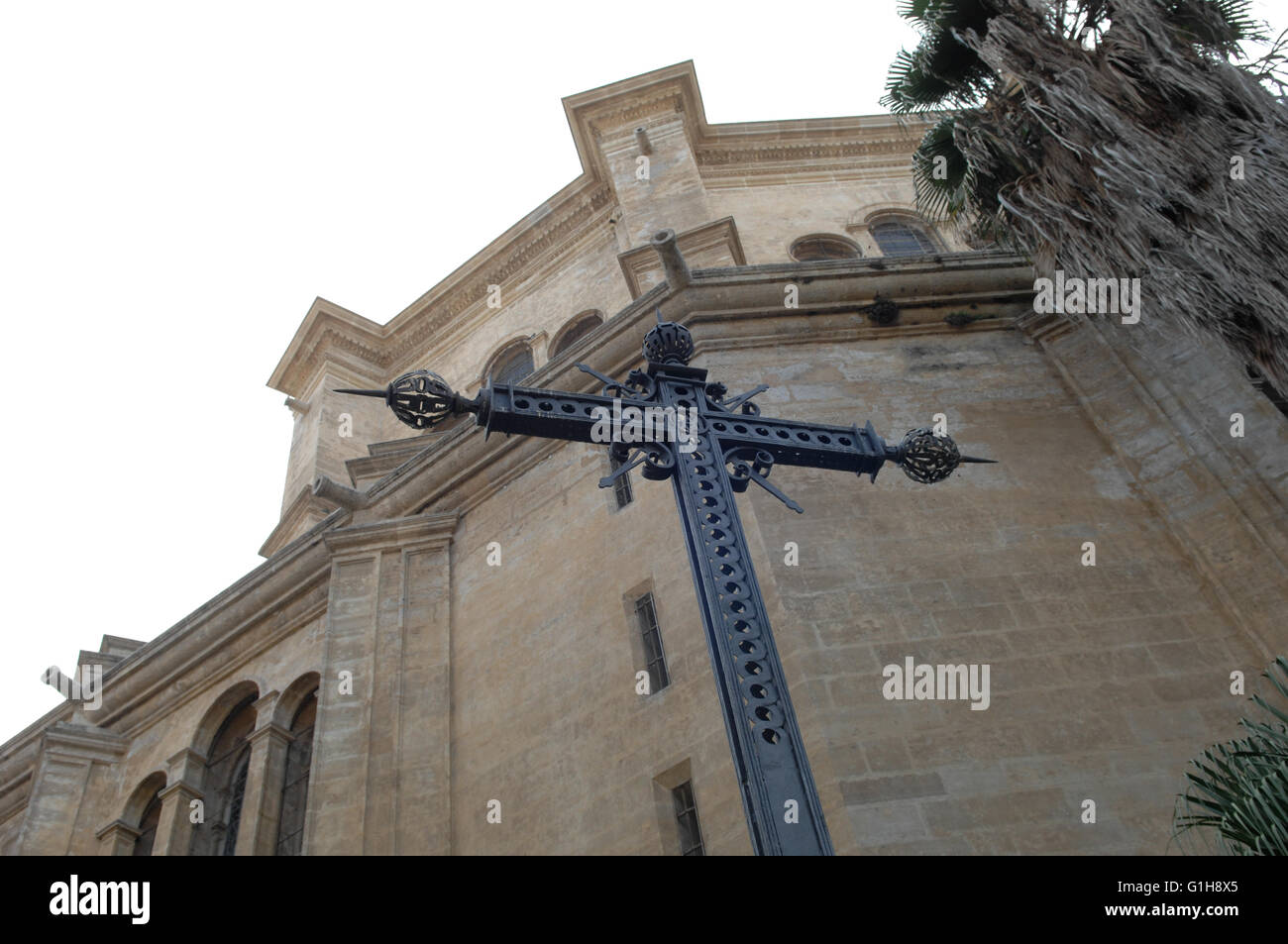 cross, redemption next to malaga cathedral - Stock Image