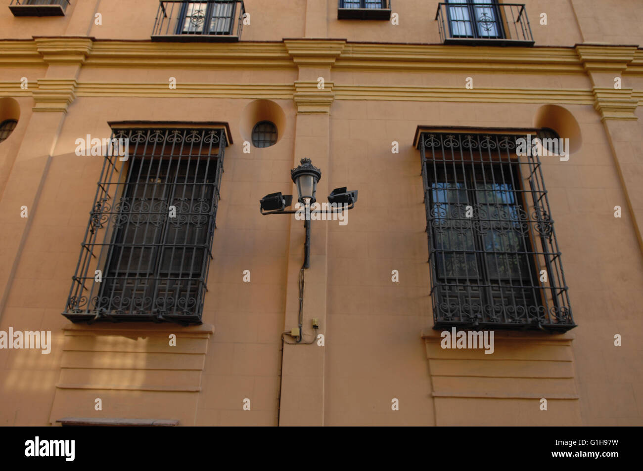 wall,security windows, streetlight,Malaga - Stock Image