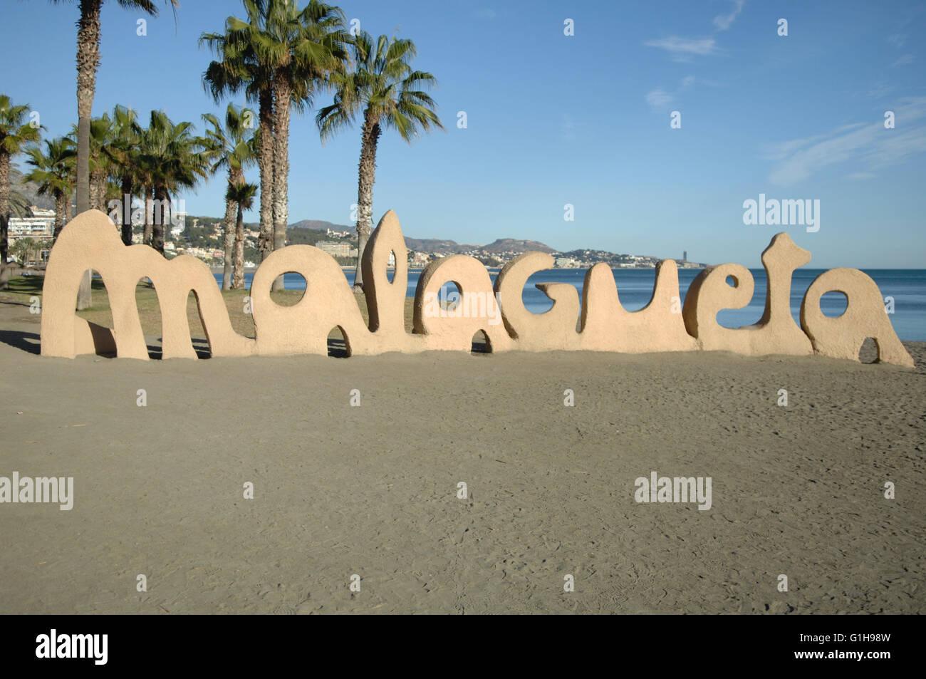 Malaga words written on beach - Stock Image