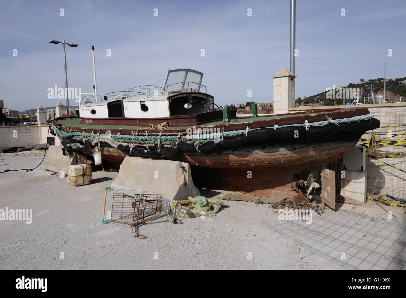 deserted, boat,seashore,harbor, harbour,Malaga - Stock Image