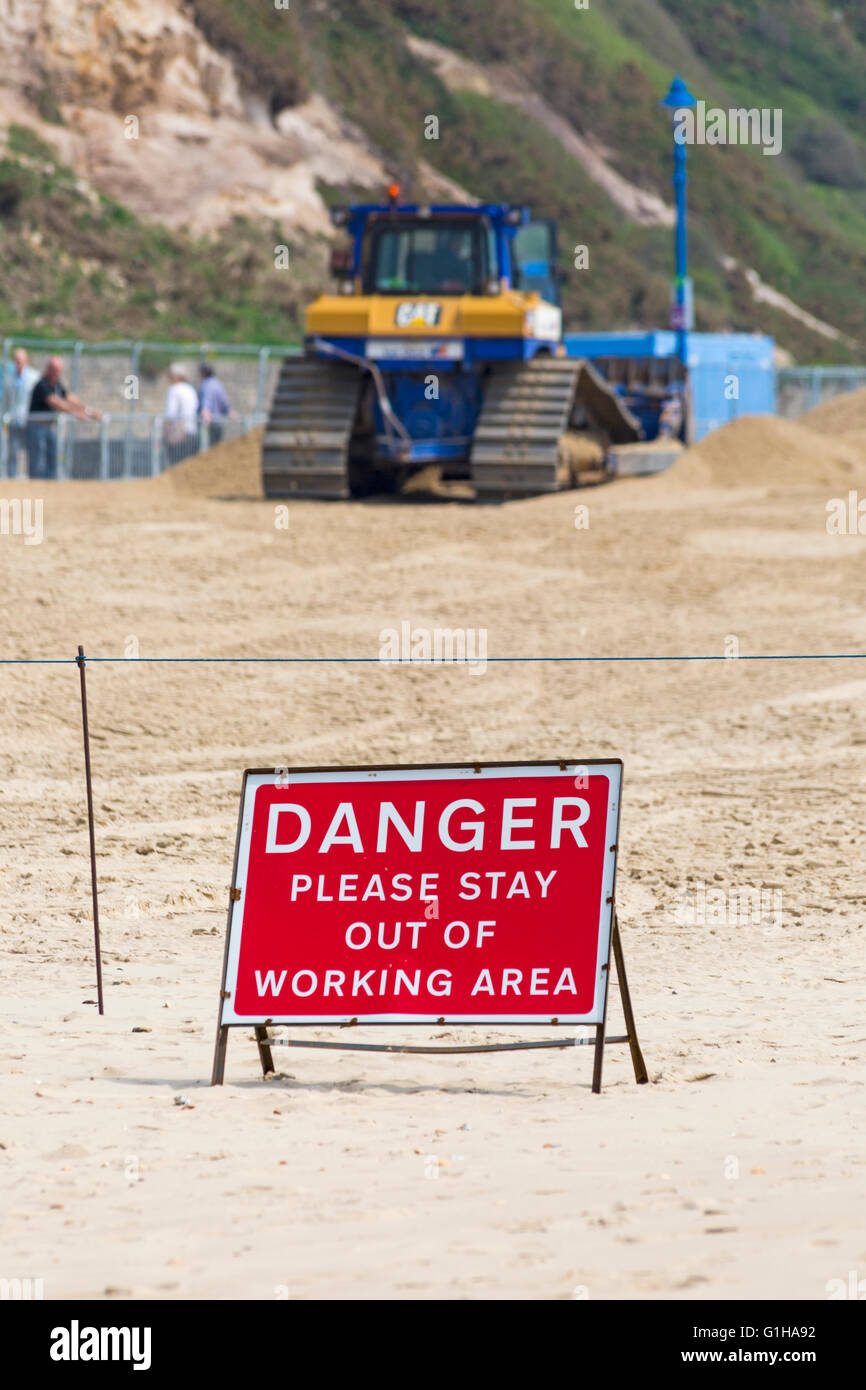 Danger please stay out of working area sign on Bournemouth beach following landslide in April - Stock Image