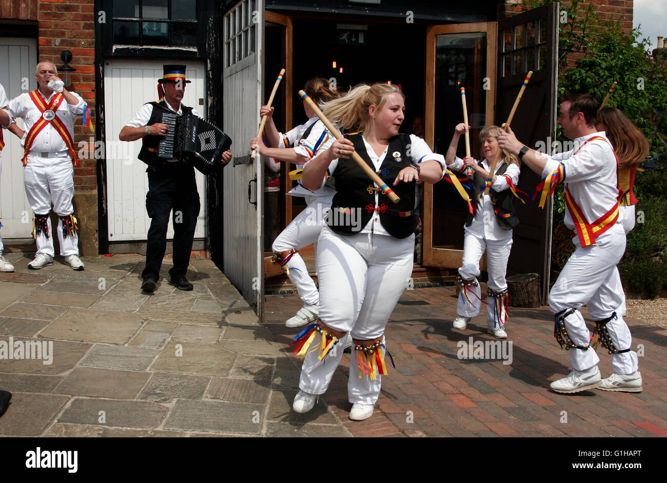 Morris dancers and musicians perform outside the Bell pub in Ticehurst, East Sussex, Britain May 15, 2016. Copyright - Stock Image