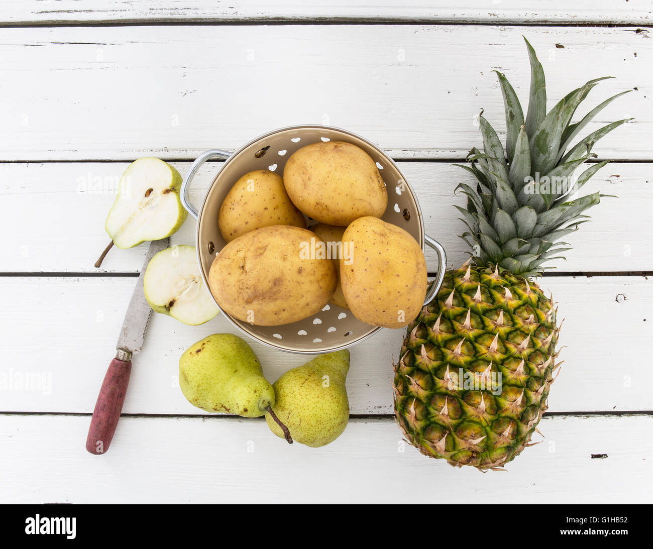 Overhead Still Life with Fruit and vegetables on wooden background - Stock Image