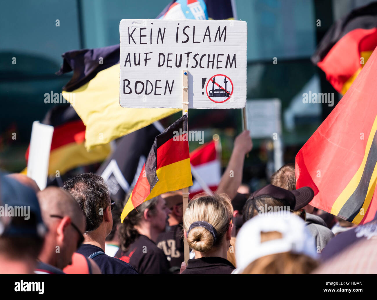 Far-right demonstrators protest against Islam, refugees and Angela Merkel in Berlin. Sign says ' No Islam on - Stock Image