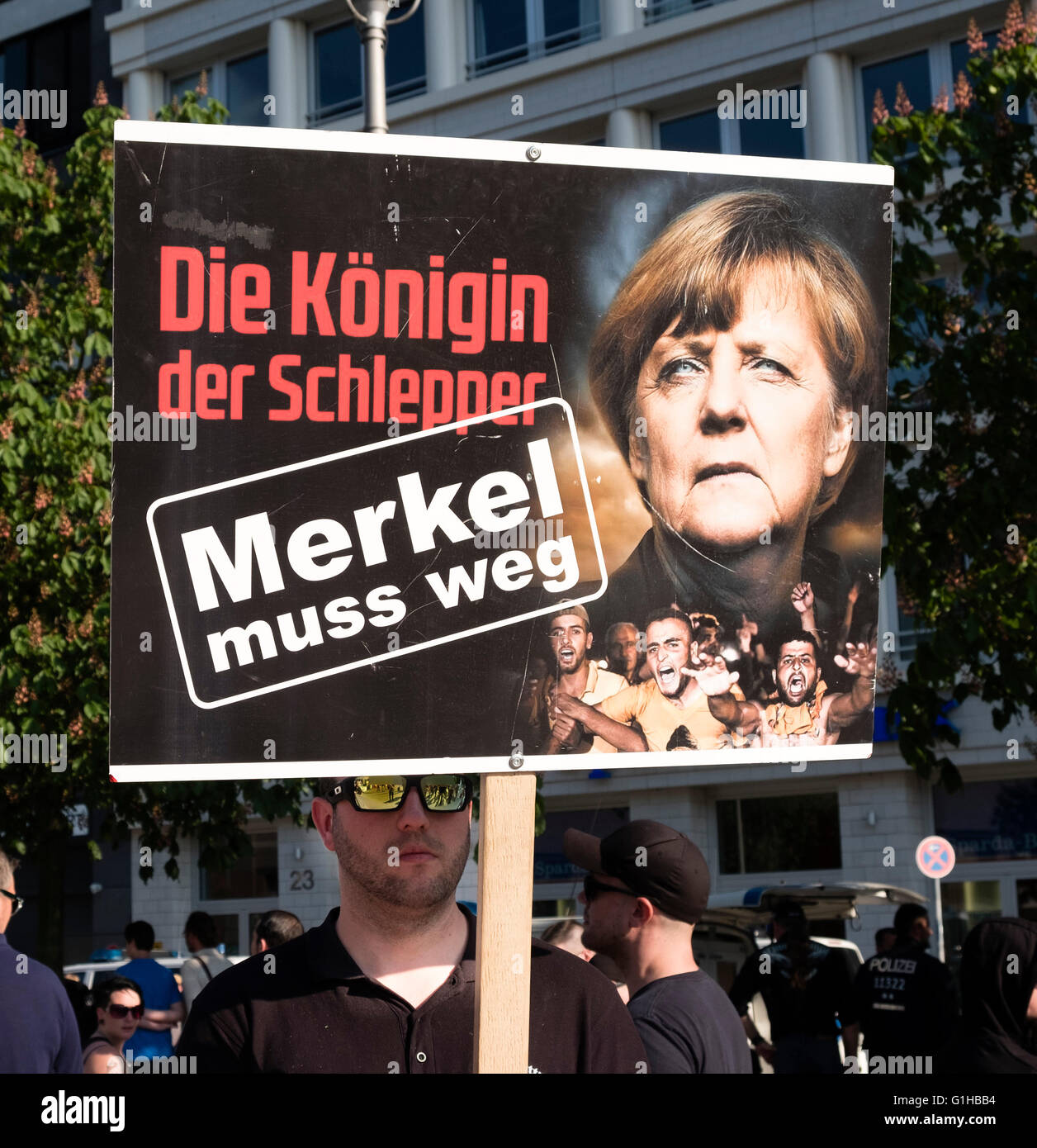 Far-right demonstrators protest against Islam, refugees and Angela Merkel in Berlin. Sign sign, 'The Queen of - Stock Image