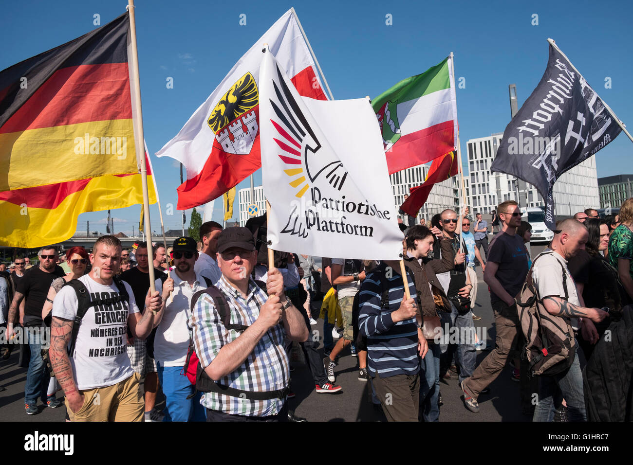 Far-right demonstrators protest against Islam, refugees and Angela Merkel in Berlin - Stock Image