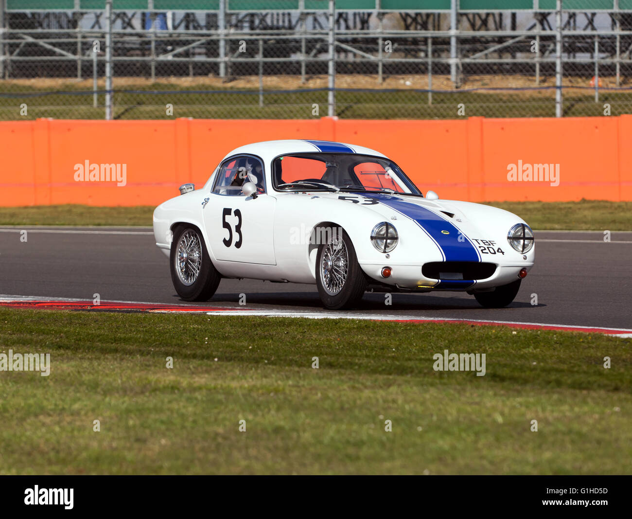 A Lotus Elite type 14, driven by Paul and Ewan Bason, during the Silverstone Classic Media Test Day - Stock Image