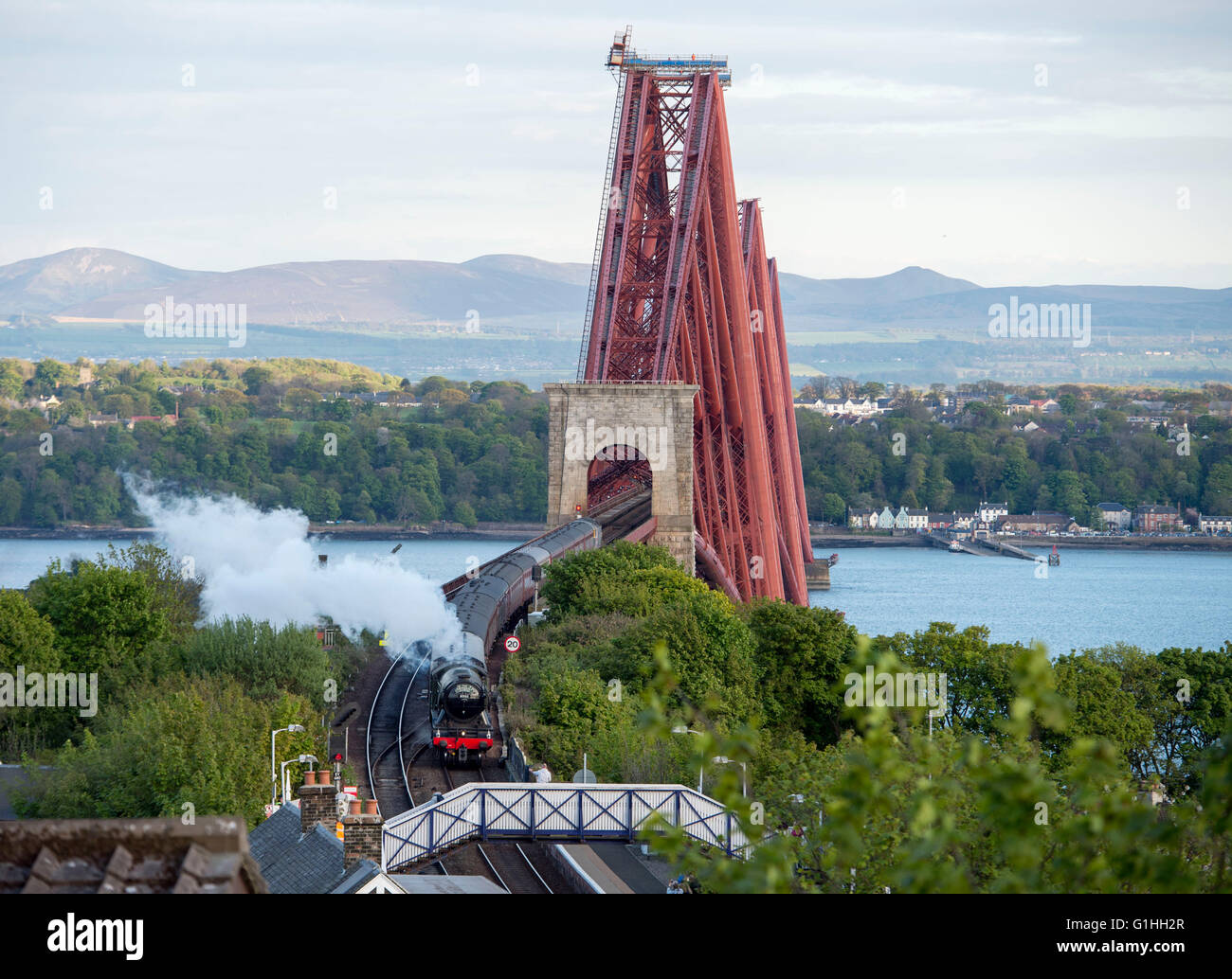 The Flying Scotsman steam train arriving at North Queensferry station after crossing the Forth Rail Bridge on a - Stock Image