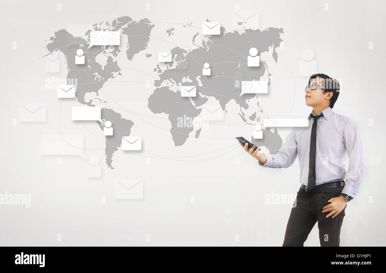 Email  Network and Technology - Asian Man Holding Smartphone White Background - Stock Image