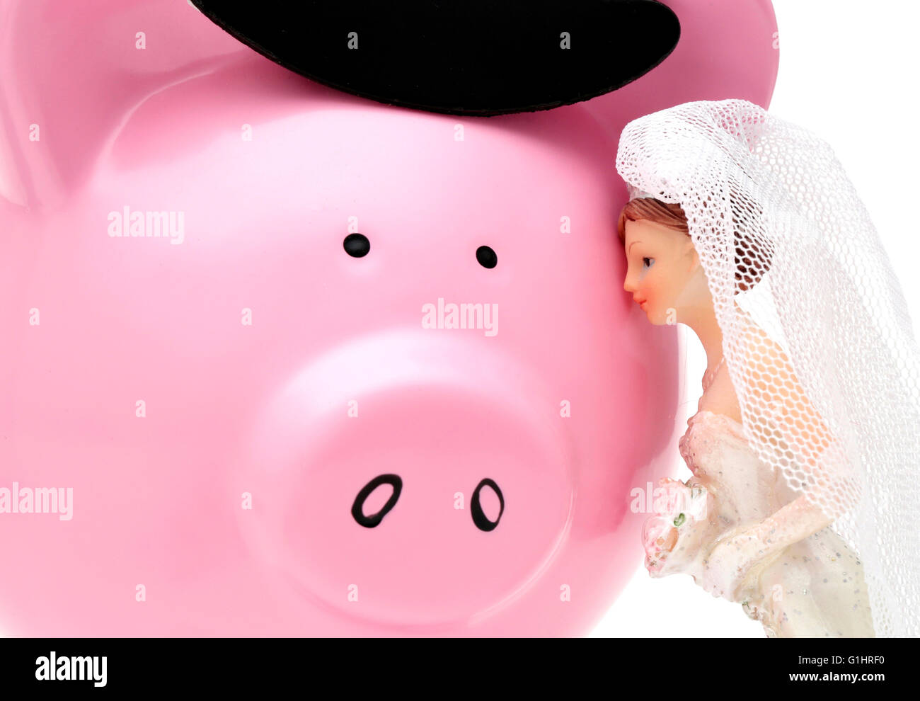 A woman sees her husband as a piggy bank - Stock Image