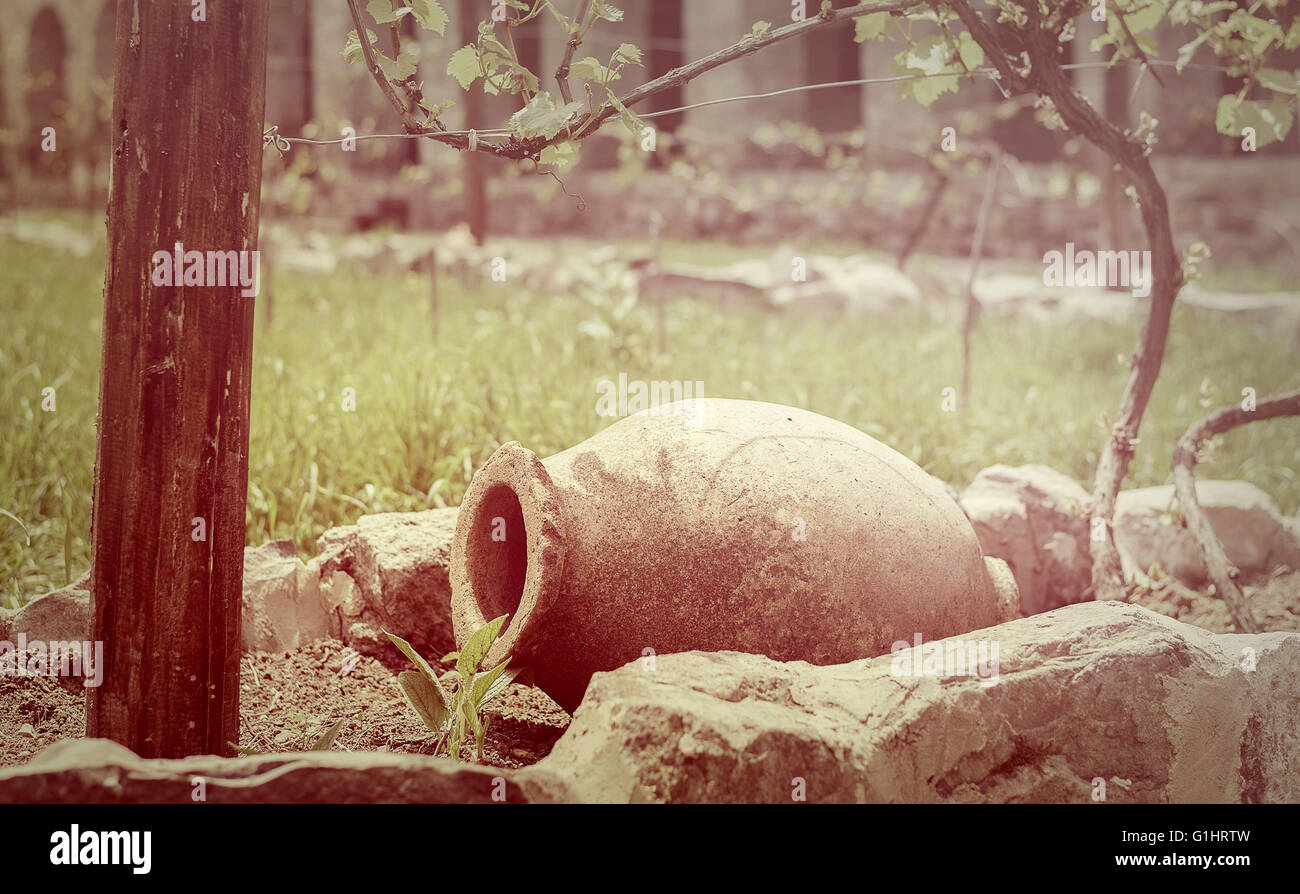earthen vessel for storing wine in the vineyard - Stock Image