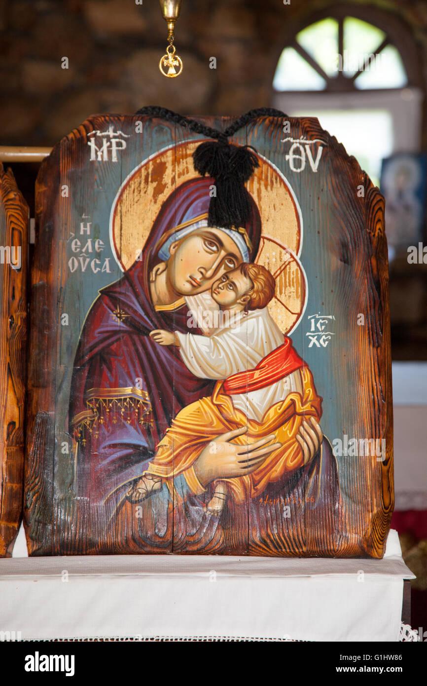 aureole child Christ Mother Mary Christianity church female frame god Greece Greek hagiography hold holding savior - Stock Image