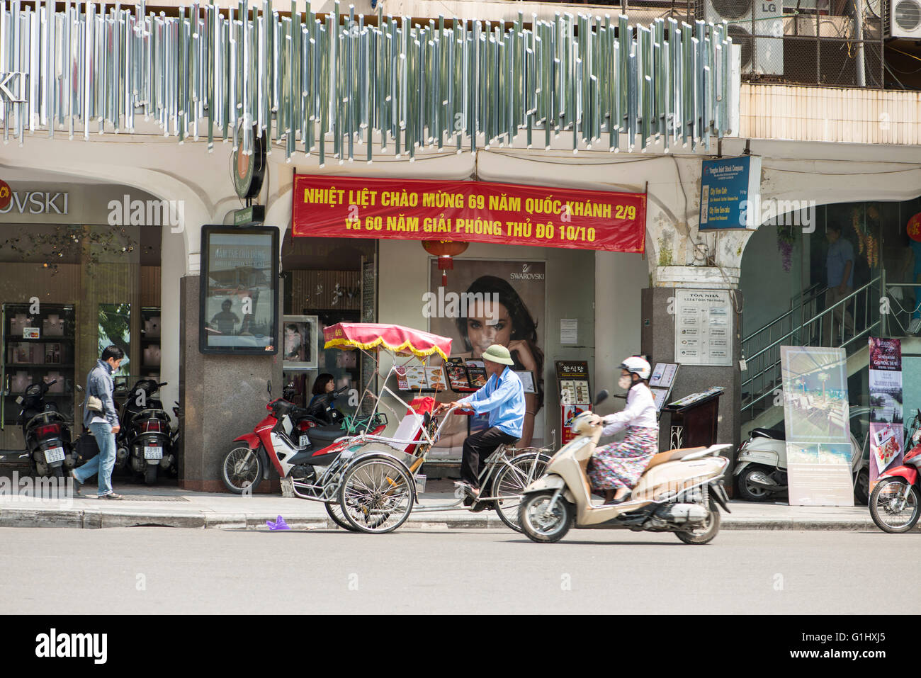 New Shops In Old Hanoi And Old Forms Of Transport Stock Photo Alamy