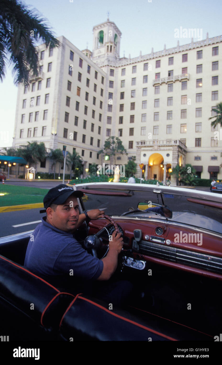 Cuban taxi driver at the wheel of  old American vintage convertible car in Havana Cuba Caribbean - Stock Image