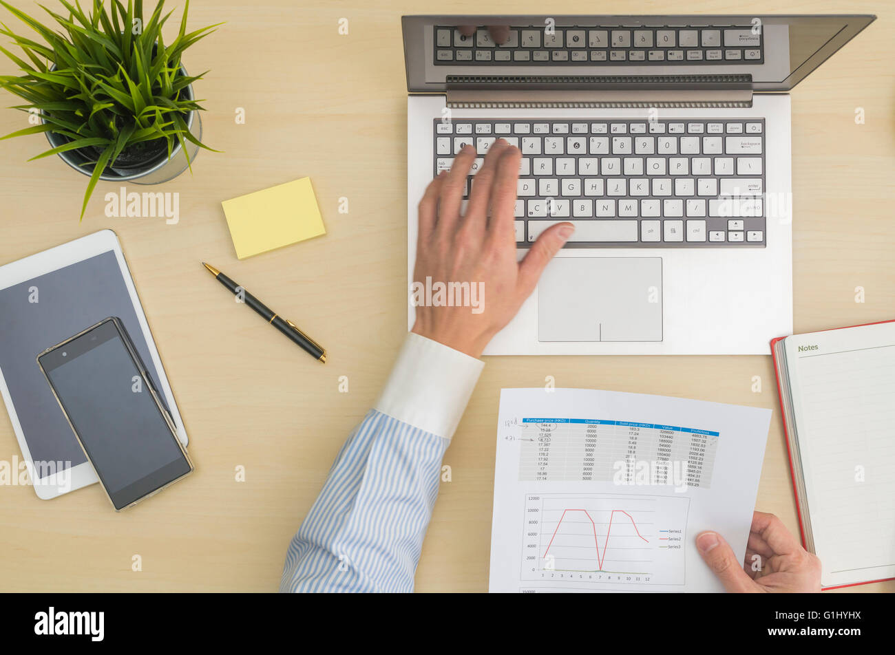 Data input and analysis at office - Stock Image
