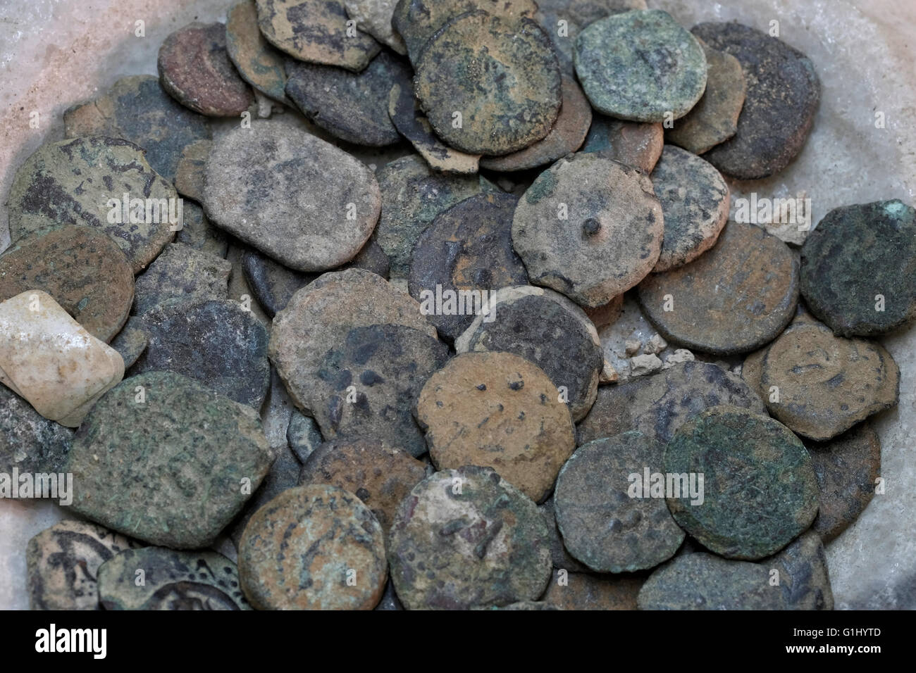 Stack of ancient coins at Baidun antiquity shop located on Via Dolorosa Old city East Jerusalem, Israel - Stock Image
