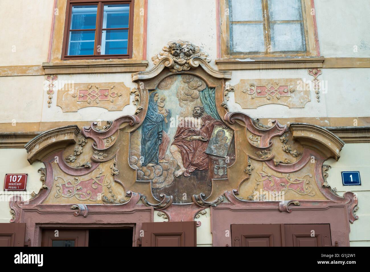 Fresco on wall of U Cerneho Vola (The Black Ox) at Loretanska street, Prague, Czech Republic, Europe - Stock Image