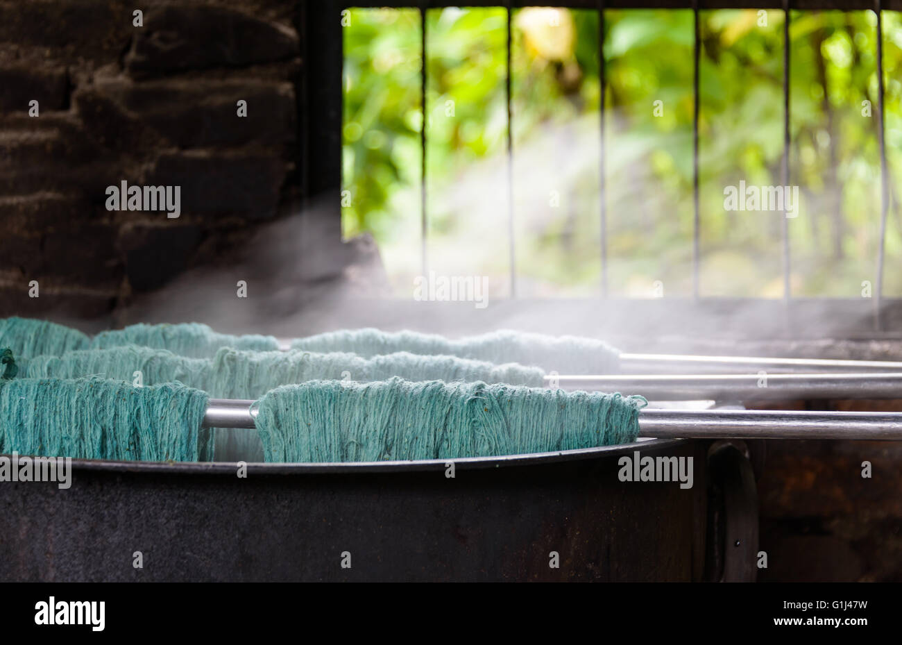 Natural wool dyeing in a carpet factory, Nepal - Stock Image