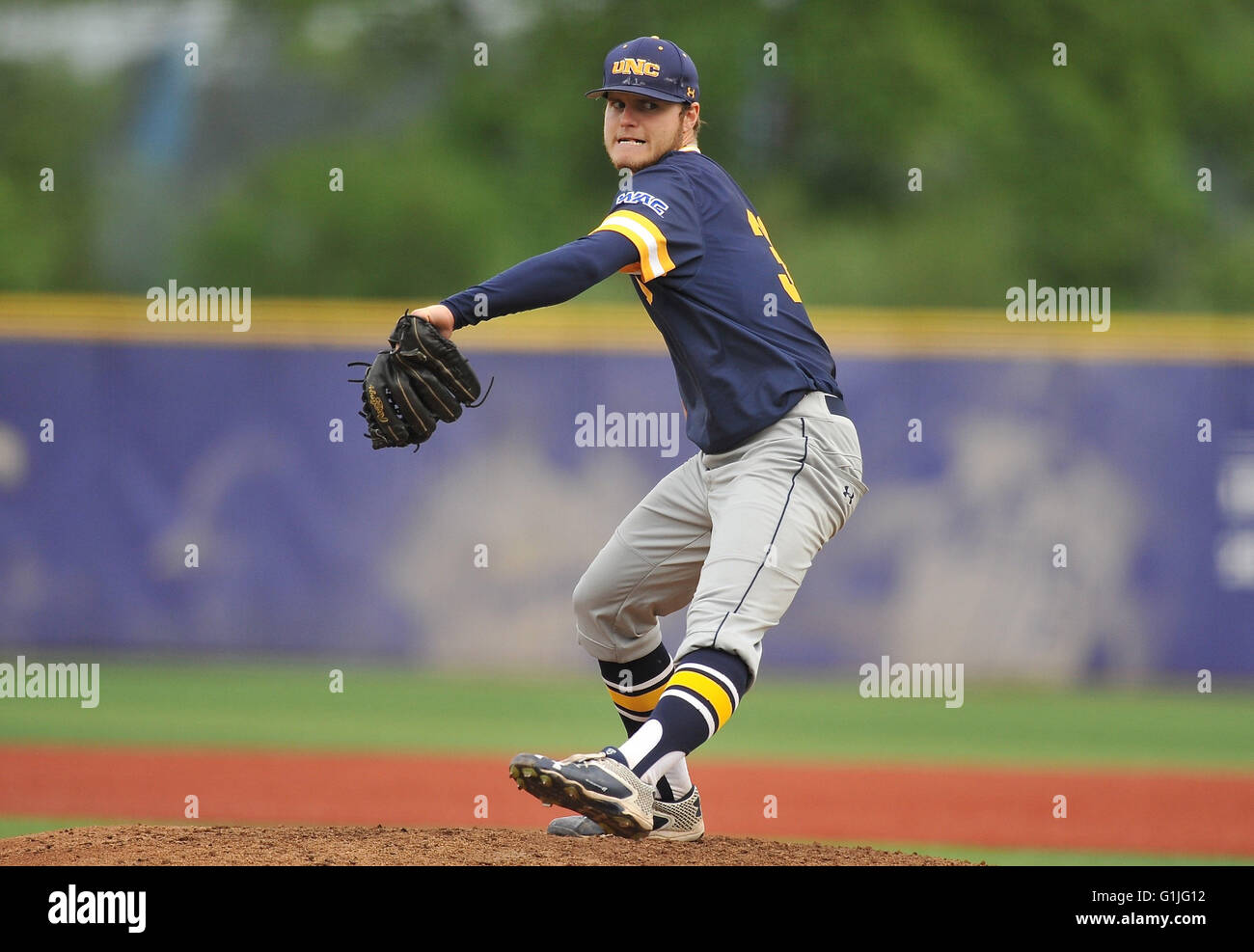 Northern Colorado pitcher Cody Carroll (30) throws a strike in a non-conference game against the University of Washington. - Stock Image