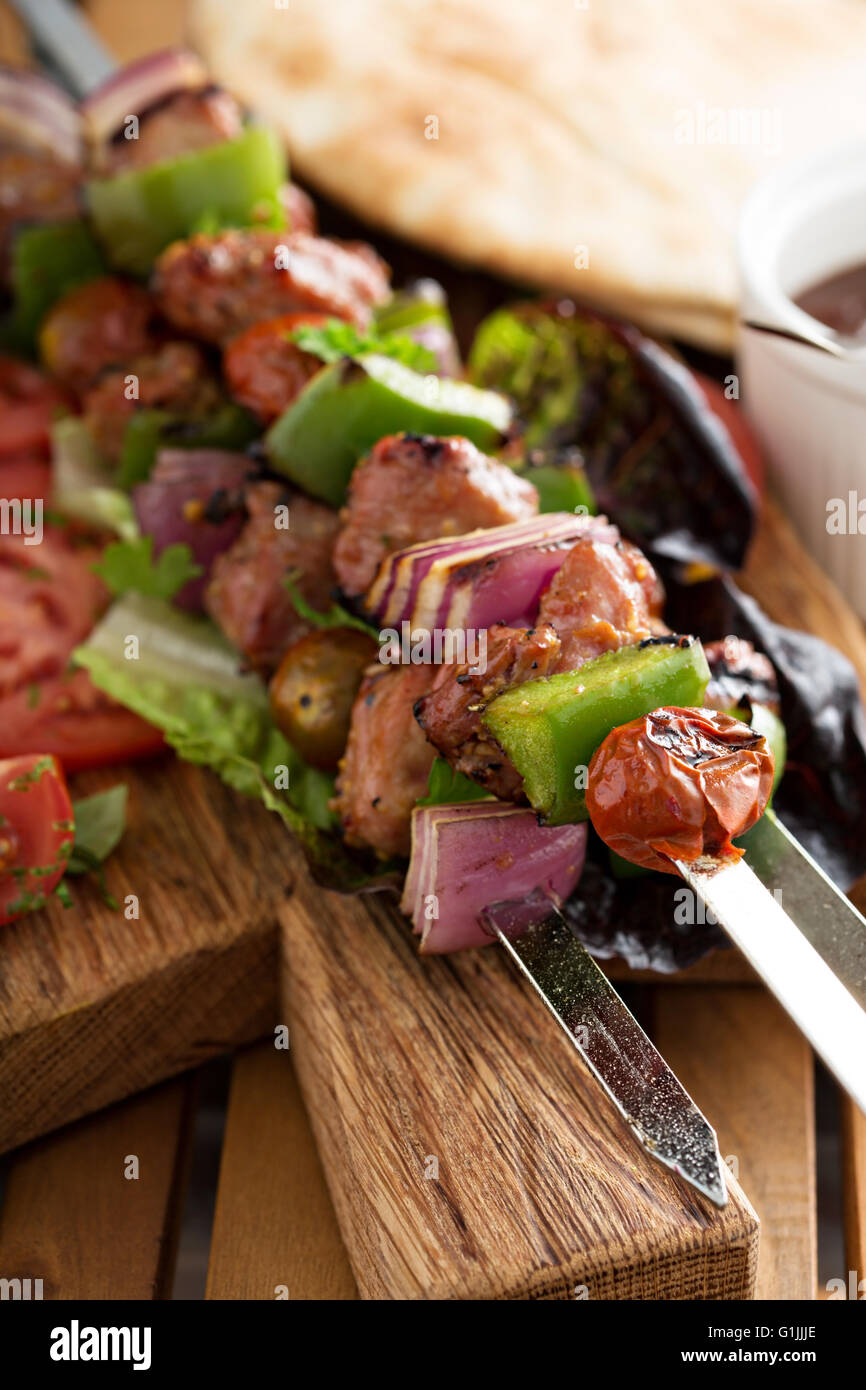 Veal kebabs with vegetables - Stock Image