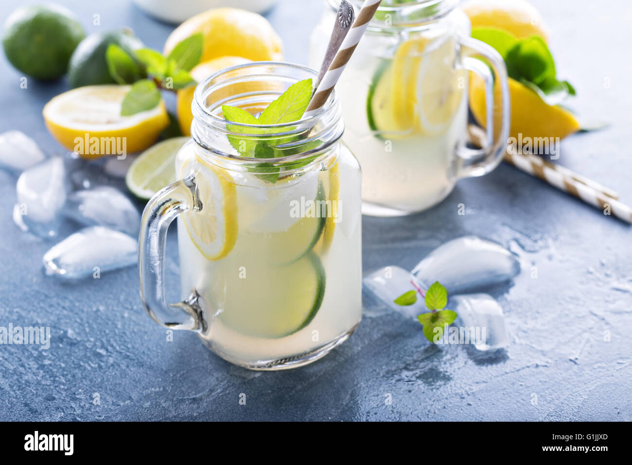 Fresh citrus lemonade in mason jars - Stock Image