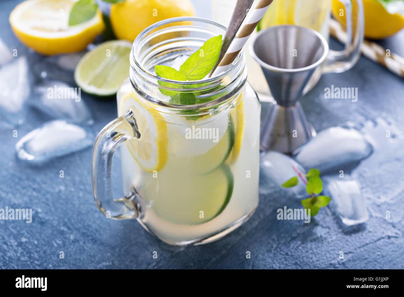 Spiked citrus lemonade in mason jars Stock Photo