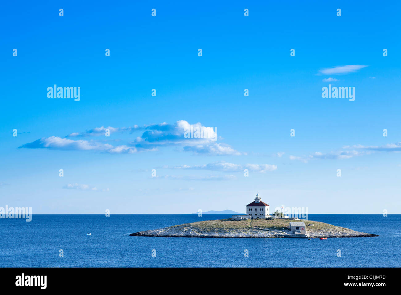 A lone island in the sea. Locaten in Croatia near island of Hvar - Stock Image