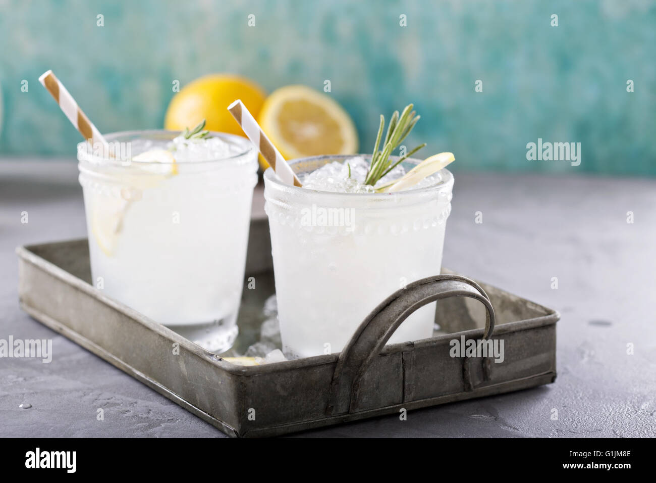 Lemon rosemary cocktail on a tray - Stock Image