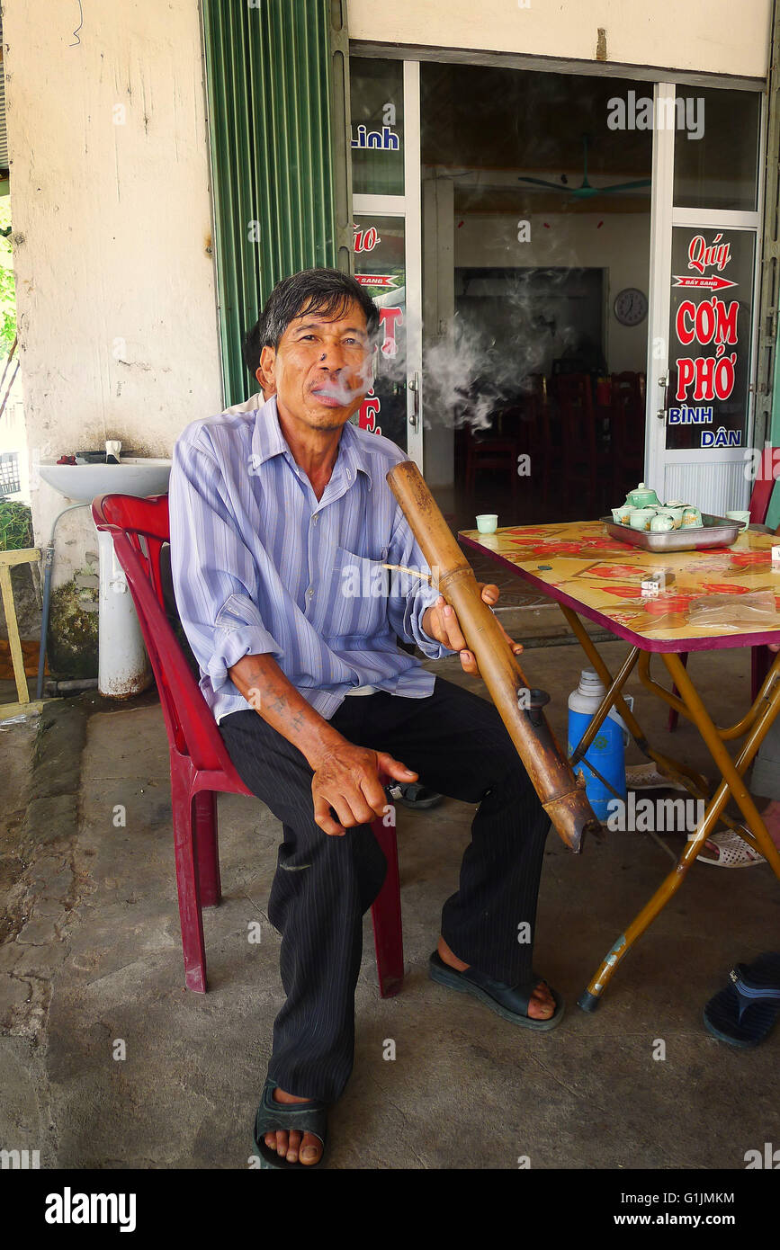 Asia, South East Asia, Vietnam, Ninh Binh, Smokin' Through the Bamboo Pipe - Stock Image