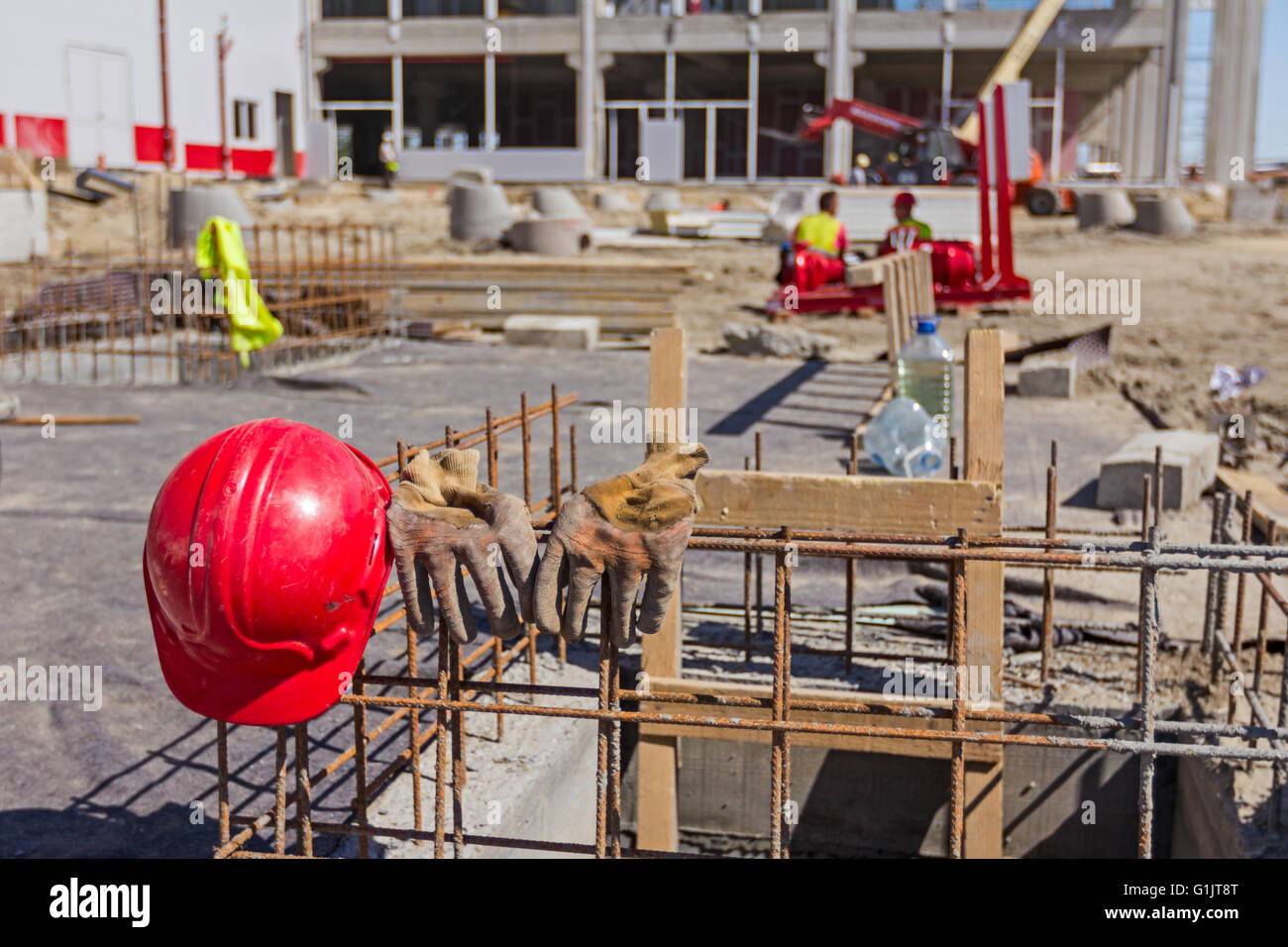 Safety equipment has been put down with construction site background. - Stock Image