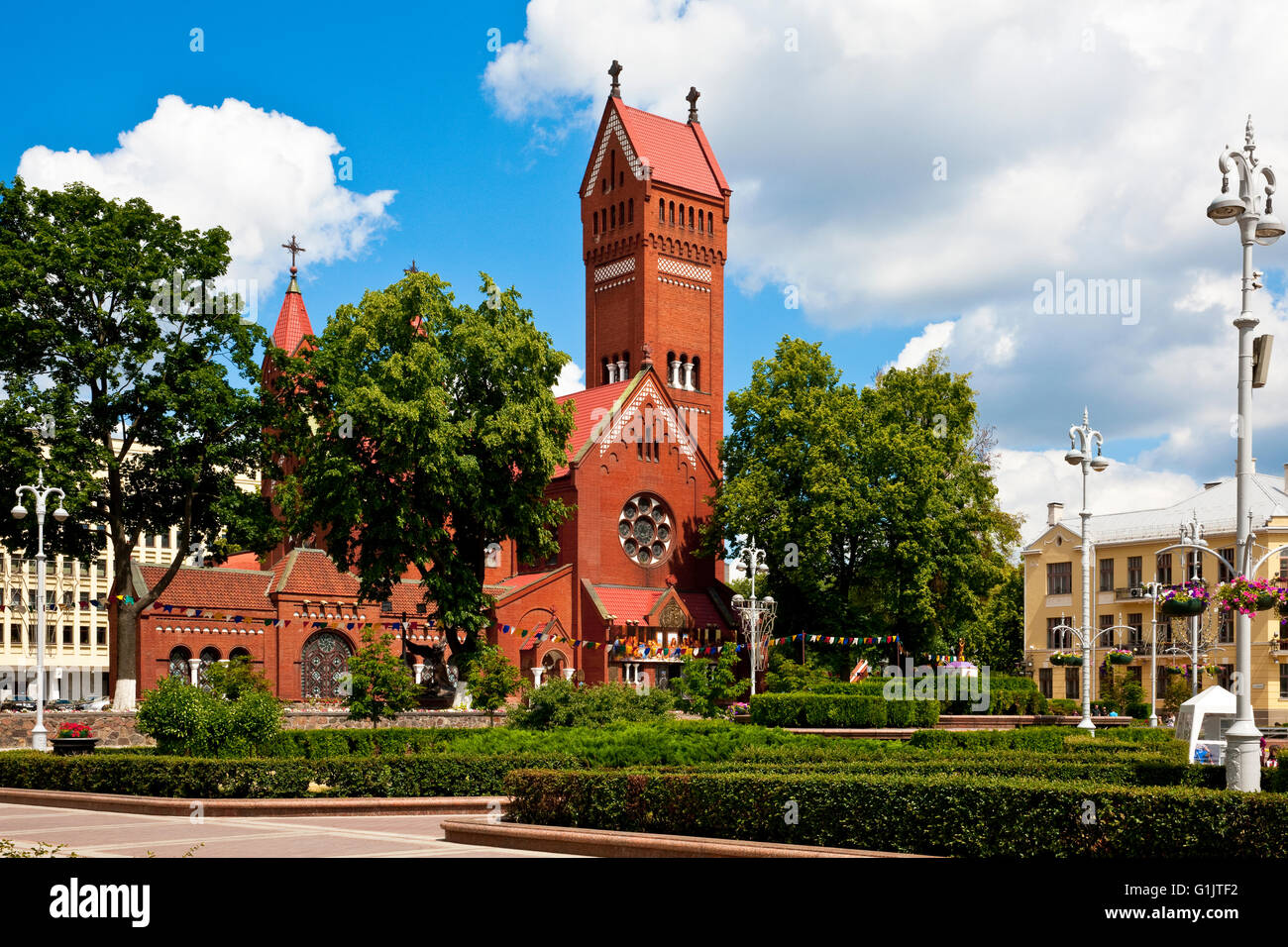 The Red Church ( church of Saint Simon and Helena ) and the Independence Square in the centre of Minsk, Belarus - Stock Image