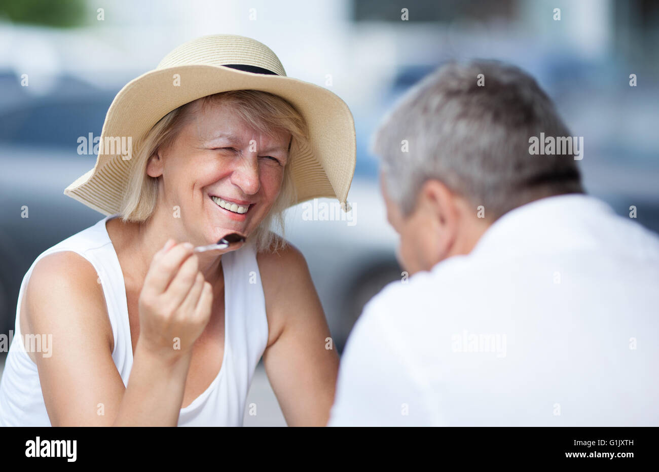 Smiling happy woman relaxing with her husband - Stock Image