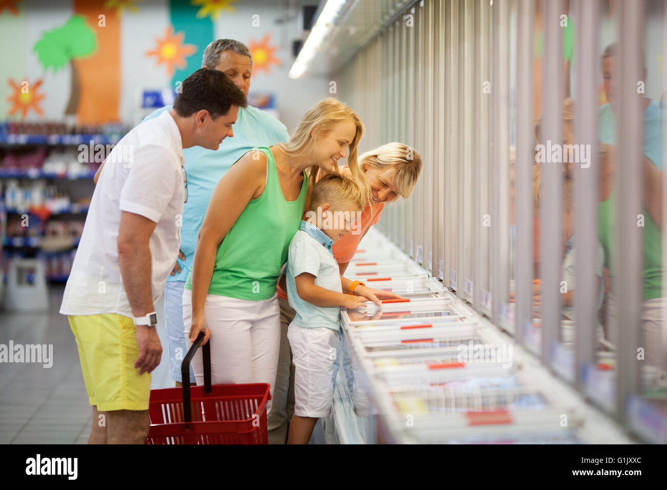 Young family shopping with the Grandparents - Stock Image