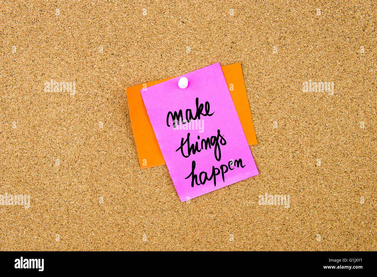 Make Things Happen written on paper note pinned on cork board with white thumbtack, copy space available Stock Photo