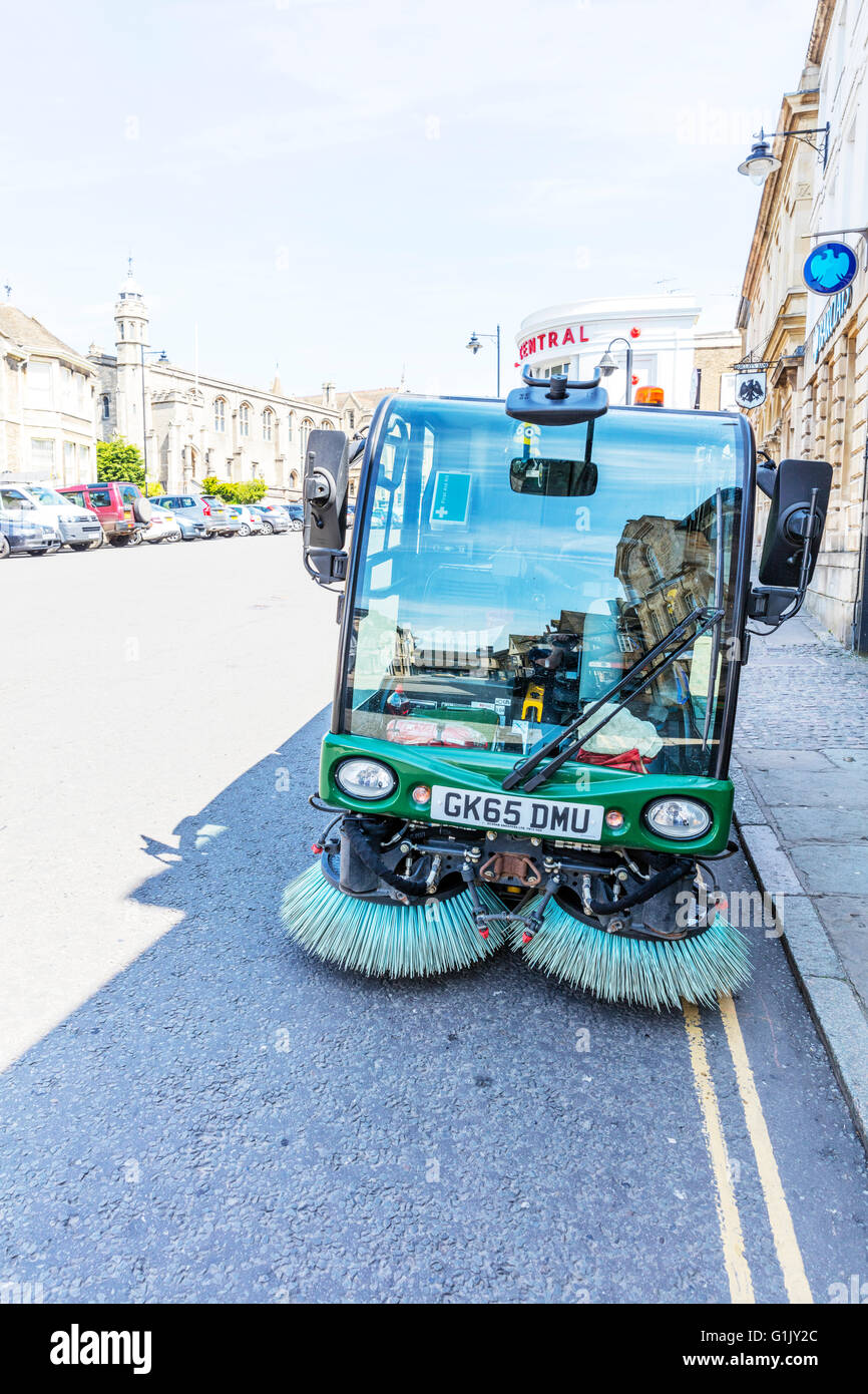 Road sweeping machine roadsweeping mechanical street cleaner brushes on front collect waste litter UK England - Stock Image